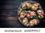 bruschettas served on the... | Shutterstock . vector #644099917