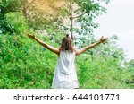 beautiful young woman outdoor.... | Shutterstock . vector #644101771