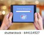 hand holding tablet with online ... | Shutterstock . vector #644114527