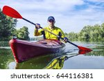 A Man Rafts On A Kayak On The...