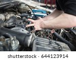 the master repairs under the... | Shutterstock . vector #644123914