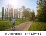 middle aged man jogging at park ... | Shutterstock . vector #644129461