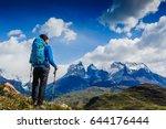 traveler with backpack hiking... | Shutterstock . vector #644176444