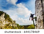 young male climber hanging by a ... | Shutterstock . vector #644178469
