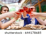 friends drinking wine on the... | Shutterstock . vector #644178685