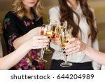 hands holding the glasses of... | Shutterstock . vector #644204989