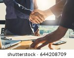 business partnership meeting... | Shutterstock . vector #644208709