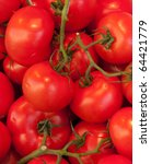 Backgrounds of fresh juicy tomatoes in a twig - stock photo