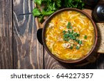 chicken soup with egg noodles... | Shutterstock . vector #644227357