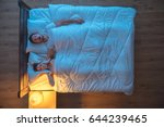 the man snore on the bed.... | Shutterstock . vector #644239465