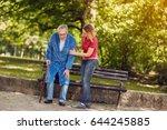 smiling daughter helping senior ...   Shutterstock . vector #644245885