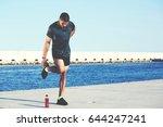 male runner stretching legs... | Shutterstock . vector #644247241