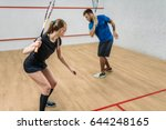 Couple With Squash Rackets ...