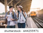 two asian tourists with... | Shutterstock . vector #644255971