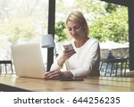 female freelancer read text... | Shutterstock . vector #644256235