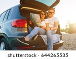 cheerful couple sitting in car... | Shutterstock . vector #644265535