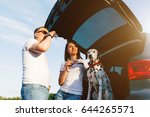 family of two person and dog... | Shutterstock . vector #644265571