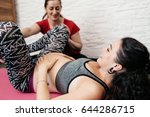 Small photo of Doula showing labor positions to a pregnant woman