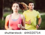 couple stretching before... | Shutterstock . vector #644320714