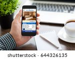 man holding phone with app... | Shutterstock . vector #644326135