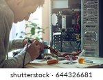 man repairman is trying to fix... | Shutterstock . vector #644326681