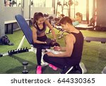 trainer and client discussing... | Shutterstock . vector #644330365