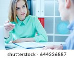 young female employee of the... | Shutterstock . vector #644336887