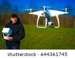 run the drone. the man launched ... | Shutterstock . vector #644361745