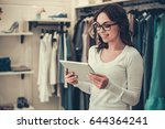 attractive female shop... | Shutterstock . vector #644364241
