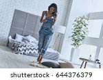 relaxing at home. full length... | Shutterstock . vector #644376379