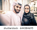 arabic couple with traditional... | Shutterstock . vector #644384695