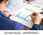 businessman working in office ... | Shutterstock . vector #644395567