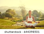 yoga at park with view of the... | Shutterstock . vector #644398501