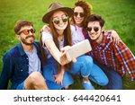 group of friends enjoying party.... | Shutterstock . vector #644420641