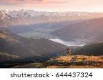 mountaineer enjoying the view... | Shutterstock . vector #644437324