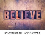 Small photo of The word Believe concept and theme written in vintage wooden letterpress type on a grunge background.
