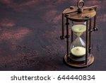 hourglass on dark rusty... | Shutterstock . vector #644440834