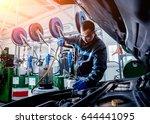 engine oil change. car repair.... | Shutterstock . vector #644441095