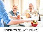 waiter serving senior couple...   Shutterstock . vector #644441491