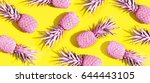 pink painted pineapples on a... | Shutterstock . vector #644443105