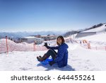 young women enjoying with snow... | Shutterstock . vector #644455261