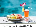 white plate with fresh fruit... | Shutterstock . vector #644480254