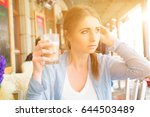 girl in a outdoor cafe with a... | Shutterstock . vector #644503489