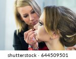 make up artist doing makeup to... | Shutterstock . vector #644509501