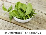 spinach in a white bowl on a... | Shutterstock . vector #644556421