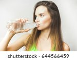 healthy woman drinks water | Shutterstock . vector #644566459
