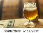 glass of light barrel aged beer ...   Shutterstock . vector #644572849
