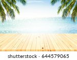 wooden table and beautiful sea... | Shutterstock . vector #644579065