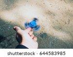 fidget spinner rotating on...   Shutterstock . vector #644583985