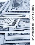 Small photo of Cash dollars in various denominations on the plane.